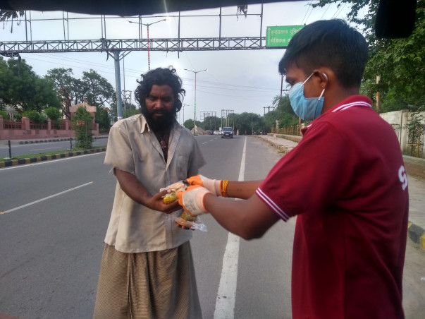 Distributing foods to Poor's and needy people. Feeding hungry stomach.