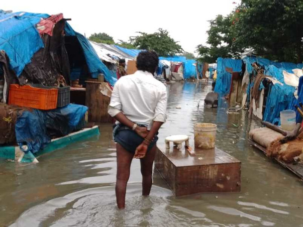 Help flood victims of a slum in Bangalore
